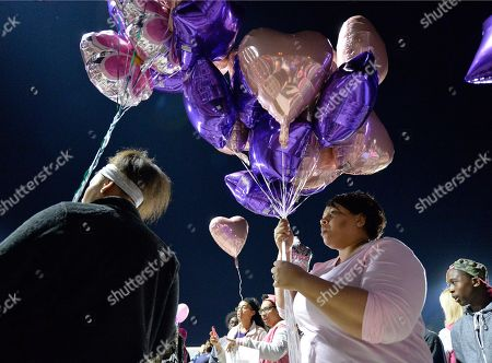 Trinity Gay Classmates of Trinity Gay prepare to release balloons in her favorite colors in her memory at Lafayette High School, in Lexington, Ky. Several thousand people, including Tyson Gay, turned out Monday night for a candlelight vigil in Kentucky to honor Gay's 15-year-old daughter, Trinity, who was fatally shot over the weekend
