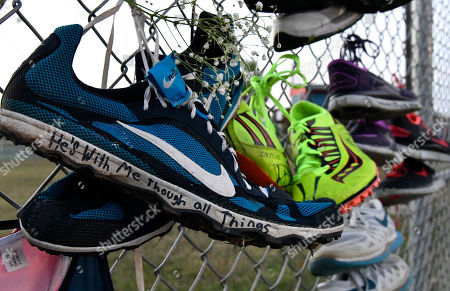 Trinity Gay Pairs of track shoes are left on the fence at the entrance to a candlelight vigil for Trinity Gay at Lafayette High School, in Lexington, Ky. Trinity Gay, the 15-year old daughter of Olympian and Lexington native Tyson Gay was shot and killed early Sunday morning
