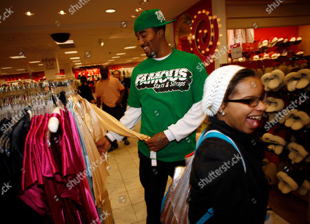 J.R. Smith Denver Nuggets guard J.R. Smith looks over a designer robe while leading 15 young shoppers from the Cope Boys and Girls Club on a holiday shopping promotion sponsored by his former teammate, Marcus Camby of the Los Angeles Clippers, at a Macy's department store in the Cherry Creek Mall in Denver on