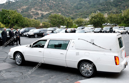 A hearse pulls up at the funeral of David Carradine, in Los Angeles