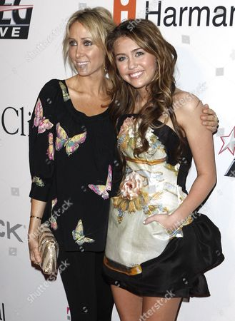 Stock Picture of Miley Cyrus, Leticia Miley Cyrus, right, and her mother Leticia arrive at the Clive Davis pre-Grammy party in Beverly Hills, Calif. on