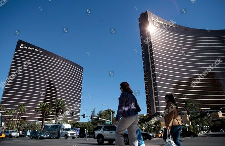 The Wynn Las Vegas, right, and its sister hotel, Encore Las Vegas, are seen in Las Vegas. In a report issued, Institutional Shareholder Services urged shareholders not vote for Elaine Wynn and withhold their votes to re-elect the two nominees, John J. Hagenbuch and J. Edward Virtue