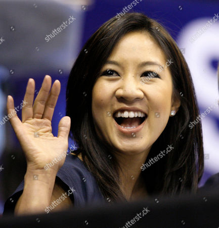 Michelle Kwan Former figure skating champion Michelle Kwan waves to fans in her new role as a television commentator during the men's short program competition at the World Figure Skating Championships in Los Angeles. In most Olympic years, the best American female figure skater would practically have her own spot on your couch by now. Her face would be all over TV, in the paper, on the cover of magazines, in the grocery store. But, the balance of power in figure skating has shifted since the Turin Olympics and its long-term impact remains to be seen