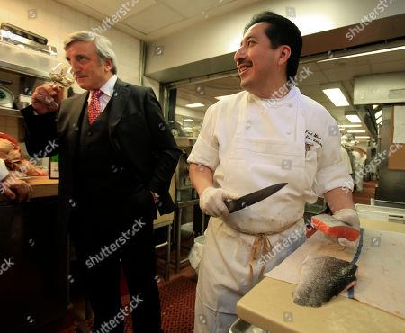 Julian Niccolini, Fred Mero Julian Niccolini, left, managing partner of the Four Seasons restaurant, in the kitchen as Fred Mero, chef de cuisine, prepares salmon, in New York