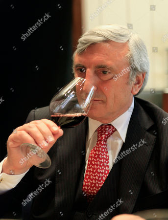 Julian Niccolini Julian Niccolini, managing partner of the Four Seasons restaurant, tastes wine, in New York