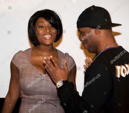 Toccara Jones, left, and DJ Whoo Kid talk before the start of a news conference for the Global Grind website in New York. Both personalities will blog for the hip hop site
