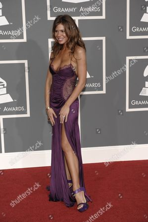 Nikki Cox Nikki Cox arrives at the 51st Annual Grammy Awards, in Los Angeles
