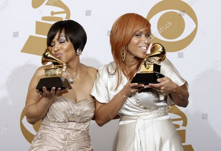 "Stock Picture of Tina Campbell, Erica Monique Atkins Tina Campbell, left, and Erica Monique Atkins of Mary Mary hold their best gospel performance awards for ""Get Up"" backstage at the 51st Annual Grammy Awards, in Los Angeles"