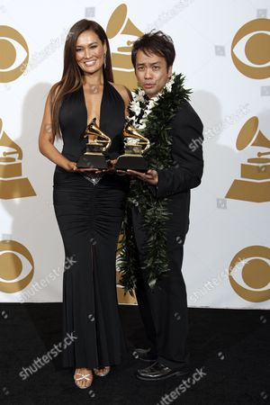 Tia Carrere, Daniel Ho Tia Carrere and Daniel Ho hold their best hawaiian music album award for 'Ikena backstage at the 51st Annual Grammy Awards, in Los Angeles