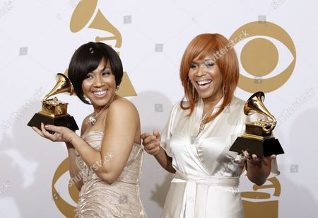 "Stock Photo of Tina Campbell, Erica Monique Atkins Tina Campbell, left, and Erica Monique Atkins of Mary Mary hold their best gospel performance awards for ""Get Up"" backstage at the 51st Annual Grammy Awards, in Los Angeles"
