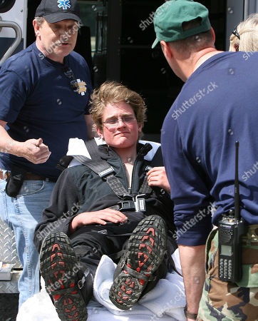 Taken April 28, 2009, Scott Mason grimaces as he gets ready to go to the hospital in Pinkham Notch, N.H. Mason, who spent three nights alone on the Northeast's highest mountain, no longer owes the state of New Hampshire more than $25,000 for the cost of his rescue. Officials with the state Fish and Game Department and attorney general's office said they have decided not to pursue the fine they imposed