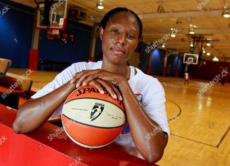 Chamique Holdsclaw Shows former Atlanta Dream forward Chamique Holdsclaw posing for a portrait after a basketball workout in Jonesboro, Ga