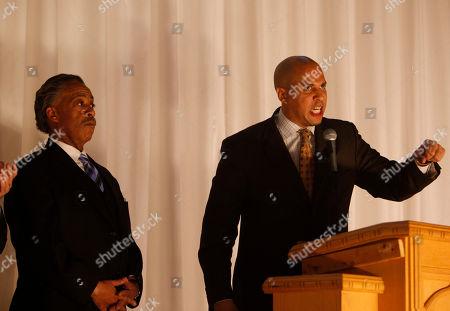Cory A. Booker, Al Sharpton Rev. Al Sharpton commemorates King holiday with Newark Mayor Cory A. Booker at a King Day Memorial Rally at Cardozo High School in Washington