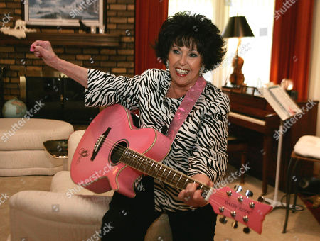 Wanda Jackson Wanda Jackson plays a pink guitar in her home in Oklahoma City