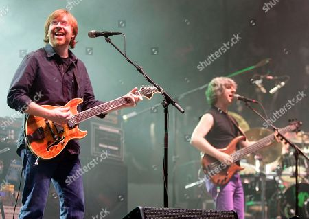 Trey Anastasio, Mike Gordon, Jon Fishman Vocalist Trey Anastasio, left, and bassist Mike Gordon of Phish perform for the first time in five years at the Hampton Coliseum for the first of three concerts by the reunited group Phish in Hampton, Va