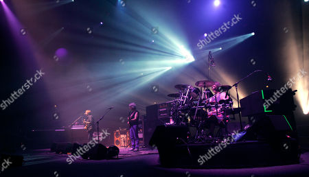 Trey Anastasio, Mike Gordon, Jon Fishman Vocalist Trey Anastasio, left, bassist Mike Gordon, center, and drummer Jon Fishman, right, of Phish perform for the first time in five years at the Hampton Coliseum for the first of three concerts by the reunited group Phish in Hampton, Va