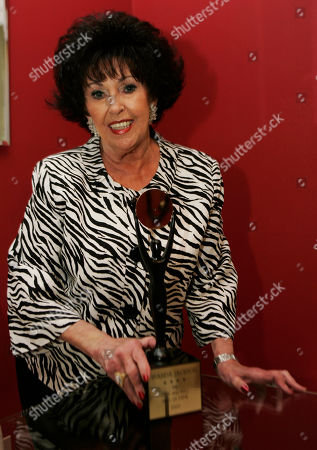 Wanda Jackson In this photo shot, Wanda Jackson poses with her Rock and Roll Hall of Fame award at her home in Oklahoma City