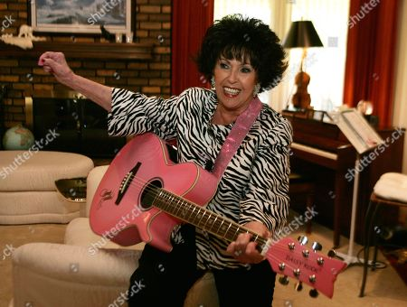 Wanda Jackson In this photo shot, Wanda Jackson plays a song for the photographer in her home in Oklahoma City