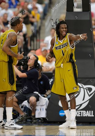 Stock Picture of DeMarre Carroll, Leo Lyons Missouri's DeMarre Carroll (1) and Missouri's Leo Lyons (5) talk during the second half of a men's NCAA college basketball tournament regional final against Connecticut in Glendale, Ariz