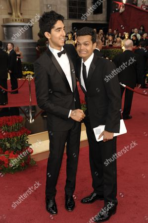 """Dev Patel, Madhur Mittal Slumdog Millionaire"""" co-stars, Dev Patel, left, and Madhur Mittal arrive for the 81st Academy Awards, in the Hollywood section of Los Angeles"""