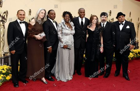 From left, Amir Bar-Lev, Joslyn Barnes, Scott Roberts, Black Kold Madina, Danny Glover, Tia Lessin, Carl Deal and Woody Richman arrive for the 81st Academy Awards, in the Hollywood section of Los Angeles