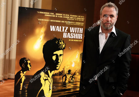 """Ari Folman Israeli director Ari Folman poses next the poster for his nominated film, """"Waltz with Bashir"""", during a news conference for best foreign language film nominees in Los Angeles on . The 81st Academy Awards will be presented Sunday, Feb. 22"""