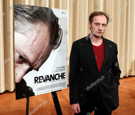 "Stock Picture of Gotz Spielmann Austrian director Gotz Spielmann poses next to the poster for his nominated film, ""Revanche"", during a news conference for best foreign language film nominees in Los Angeles on . The 81st Academy Awards will be presented Sunday, Feb. 22"