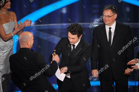 Jochen Alexander Freydank, James Franco, Janusz Kaminski James Franco, center, and Janusz Kaminski, right, present the best live action short film award to Jochen Alexander Freydank for Spielzeugland (Toyland) during the 81st Academy Awards, in the Hollywood section of Los Angeles