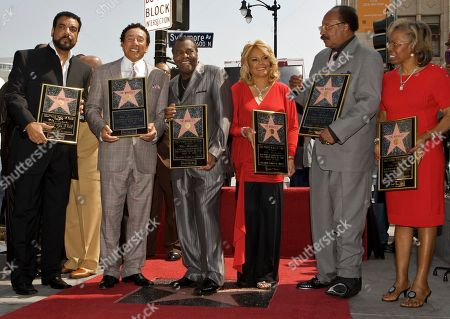 "William Bill Griffin, William Smokey Robinson, Warren Pete Moore, Claudette Robinson, Robert Bobby Rogers, Gloria White Members of The Miracles are honored with a star on the Hollywood Walk of Fame in Los Angeles on . From left: William ""Bill"" Griffin, William ""Smokey"" Robinson, Warren ""Pete"" Moore, Claudette Robinson, Robert ""Bobby"" Rogers and and Gloria White, wife of late Ronald ""Ronnie"" White"