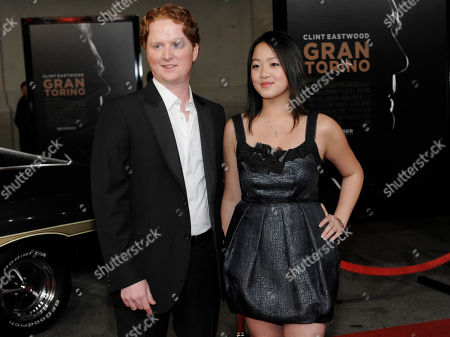 "Christopher Carley, Ahney Her Christopher Carley, left, and Ahney Her, cast members in ""Gran Turino,"" pose together at the premiere of the film at Warner Bros. Studios in Burbank, Calif"