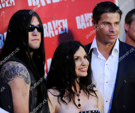 """Stock Image of Weston Cage, Meadow Williams, Roland Kickinger Weston Cage, left, Meadow Williams, center, and Roland Kickinger, cast members in the vampire film """"Raven,"""" pose together at the premiere of the film at the Academy of Television Arts & Sciences in Los Angeles"""