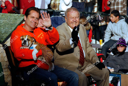 """Jimmy Van Patten, Dick Van Patten Jimmy Van Patten, left, and his father Dick Van Patten with Natural Balance Pet Foods, Inc. wave from their float themed """" Natural Entertainers,"""" as it moves along Colorado Blvd. during the 120th Rose Parade in Pasadena Calif"""