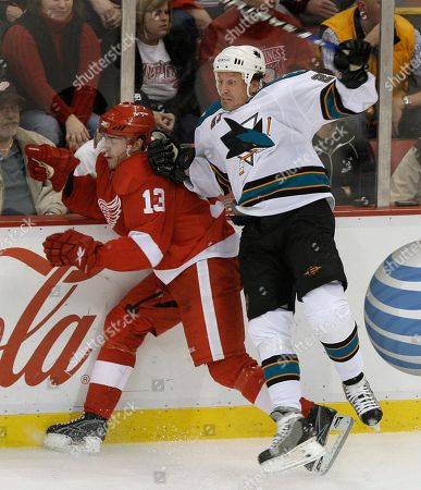 Jeremy Roenick, Pavel Datsyuk San Jose Sharks center Jeremy Roenick (27) checks Detroit Red Wings center Pavel Datsyuk of Russia in the third period of an NHL hockey game in Detroit, . Detroit won 4-1