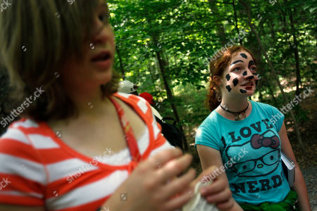 Stock Image of Katie Bohrer, 12, Bunker Hill, W.V., left, and Kira Simpson, 12, of Bluff, Utah, attend the annual picnic for the Scripps National Spelling Bee participants, in McLean, Va. on