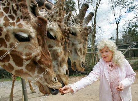 """Donna Douglas Donna Douglas, who starred in the television series """"The Beverly Hillbillies"""" tours the Audubon Zoo in this photograph taken in New Orleans"""