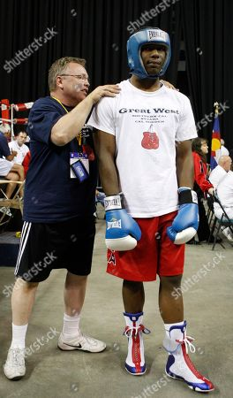 Pat Barry, Hasim Rahman Jr Coach Pat Barry works on the shoulders of boxer Hasim Rahman Jr., before his heavyweight match at the U.S. Boxing Championships in Denver., on