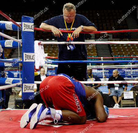 Hasim Rahman Jr, Pat Barry Hasim Rahman, Jr. drops to the mat in his corner as coach Pat Barry watches after his fight with Henry Valdez at the U.S. Boxing Championships in Denver., on