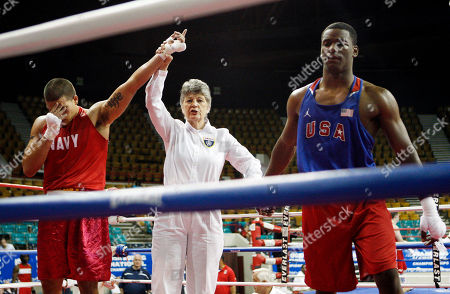 Debbie Holmes, Henry Valdez, Hasim Rahman Referee Debbie Holmes raises the hand of Henry Valdez, left, in victory over Hasim Rahman, Jr., right, after their heavyweight fight at the U.S. Boxing Championships in Denver., on