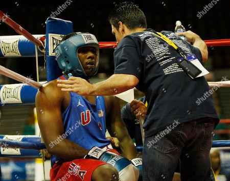 Hasim Rahman, Augie Sanchez Cornerman Augie Sanchez talks to boxer Hasim Rahman, Jr., in between rounds at the U.S. Boxing Championships in Denver., on