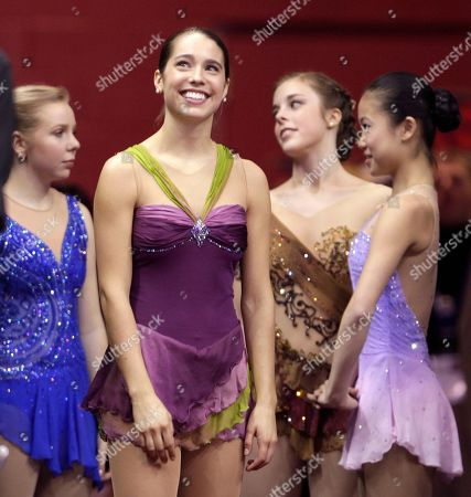 Alissa Czisny, Racheal Flatt, Caroline Zhang, Ashley Wagner Gold medalist Alissa Czisny, second from left, smiles out at the crowd while waiting to receive her medal after winning the ladies free skate at the U.S. Figure Skating Championships in Cleveland . With her are the other medalists, from left, silver medalist Racheal Flatt, pewter medalist Ashley Wagner, and bronze medalist Caroline Zhang