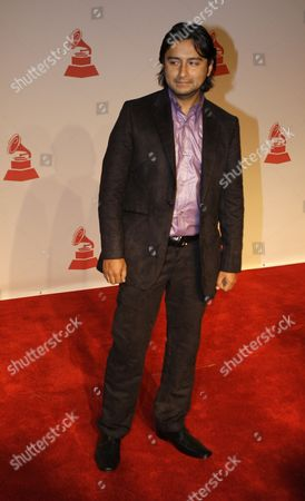 Alex Campos Alex Campos arrives at the Latin Recording Academy Person of the Year tribute in honor of Gloria Estefan on in Houston