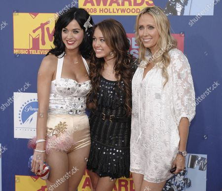 Katy Perry, Miley Cyrus, Leticia Cyrus Katy Perry, left, poses with Miley Cyrus, center and her mother Leticia Cyrus at the 2008 MTV Video Music Awards held at Paramount Pictures Studio Lot, in Los Angeles