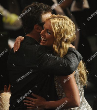 Stock Image of Britney Spears, Larry Rudolph Britney Spears and her manager, Larry Rudolph hug after she wins one of three awards at the 2008 MTV Video Music Awards held at Paramount Pictures Studio Lot, in Los Angeles