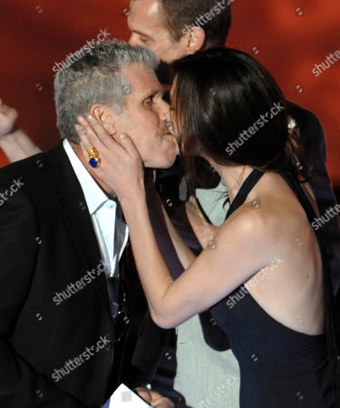 Ron Perlman, Anna Walton Actor Ron Perlman,left, is kissed by actress Anna Walton as they accept the Award for Best Fantasy Movie, Hellboy II: Golden Army, at the Scream Awards on in Los Angeles