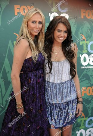 Miley Cyrus; Leticia Cyrus Miley Cyrus, left, and her mother, Leticia arrive at the Teen Choice Awards in Universal City, Calif., on