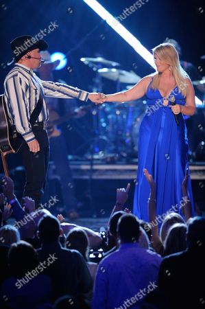 Stock Picture of Garth Brooks, Tricia Yearwood Garth Brooks and Tricia Yearwood perform at the 43rd Annual Academy of Country Music Awards, in Las Vegas