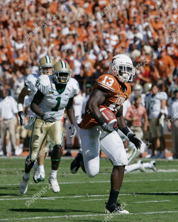 Thomas White, Kendall Wright, Ryan Palmer Texas corner back Ryan Palmer, right, returns an interception 22 yards for a touchdown during second quarter NCAA college football action against Baylor, in Austin, Texas. Palmer is pursued by Baylor's Kendall Wright (1) and Thomas White, left. Texas won it 45-21