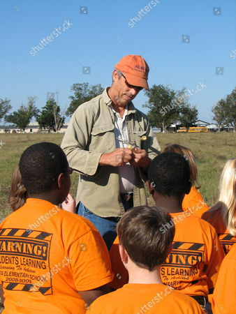 Auburn University farm economist Bob Goodman shows sugar cane to a group of Bay Minette students from Delta Elementary School gathered at a sugar cane field to hear Alabama Gov. Bob Riley discuss a biofuels project, in Atmore, Ala