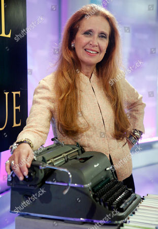 """Danielle Steel Author Danielle Steel poses with a 1946 manual Olympia typewriter, similar to the one she uses to write her novels, after her appearance on the NBC """"Today"""" television show in New York"""
