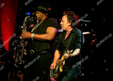Bruce Springsteen Bruce Springsteen looks on as Clarence Clemons plays the saxaphone as Springsteen and the E Street Band play a benefit concert for the renovation of the Count Basie Theatre in Red Bank, N.J